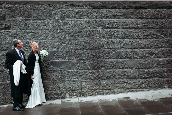 the bride and groom walk along the street during post wedding photography in melbourne