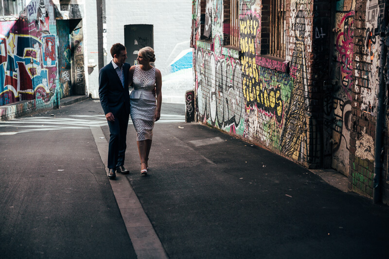 bride and groom walk through the alleys of melbourne, post wedding photography